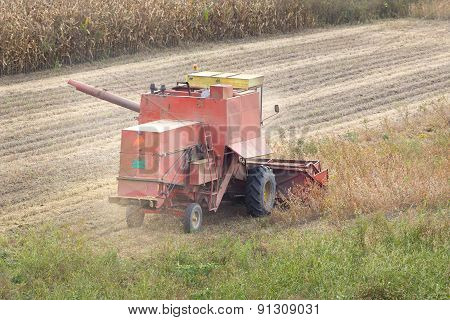 Combine In Soybean Field