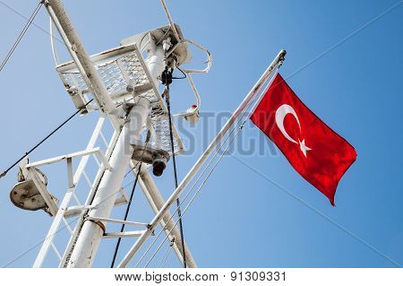 Ship Mast With The Turkish Flag Over Blue Sky