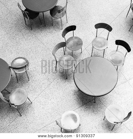 Round Tables And Chairs Stand In Empty Cafe