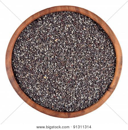 Poppy Seeds In A Wooden Bowl On A White
