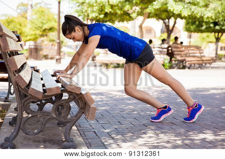 Woman Stretching At A Park