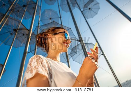 Woman with mobile phone on modern abstract background