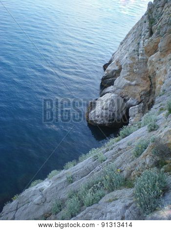 Rock Near The Dark Blue Sea