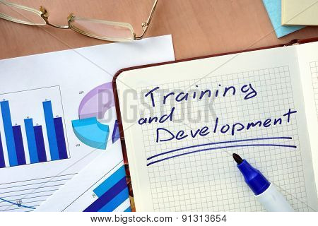 Notepad with word training and development concept.