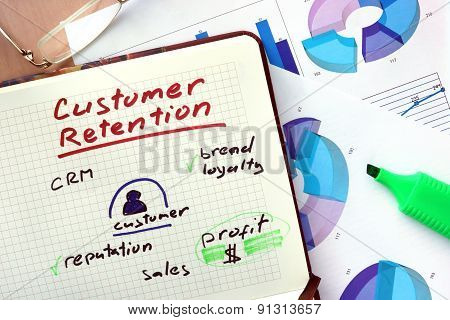 Notepad with word customer retention concept.