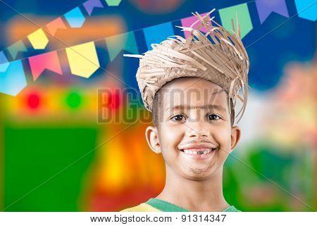 Boy wearing caipira clothes for the Brazilian Junina Party (Festa Junina)