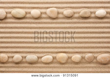 Two Rows Of White Stones  On The Sand