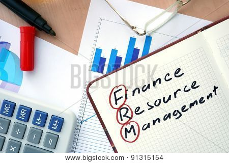Notepad with word FRM finance resource management concept.