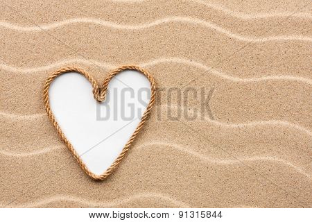 Heart Made Of Rope With A White Background On The Sand