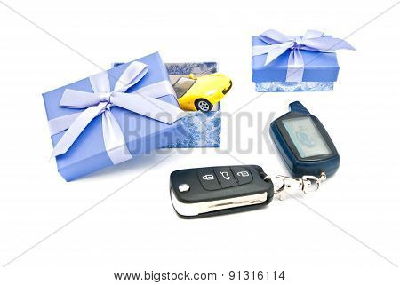 Car Keys, Sport Car And Blue Gift Boxes