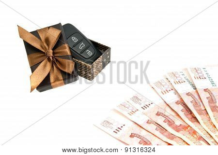 Car Keys, Banknotes And Brown Gift Box
