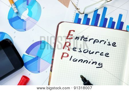 Notepad with word ERP enterprise resource planning concept.