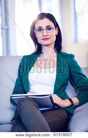 Therapist smiling at the camera in her office