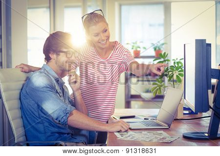 Happy designers working together in creative office