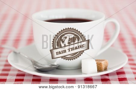 Fair Trade graphic against coffee on a tablecloth