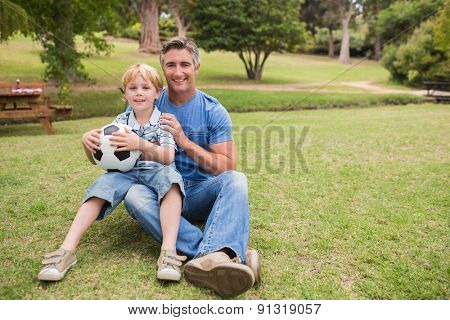 Happy father with his son at the park on a sunny day
