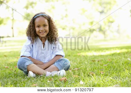 African American Girl Sitting In Park