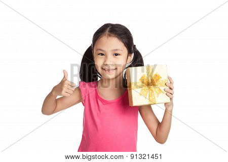 Little Asian Girl With Gift Box Show Thumbs Up