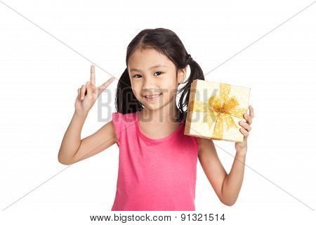 Little Asian Girl With Gift Box Show Victory Sign