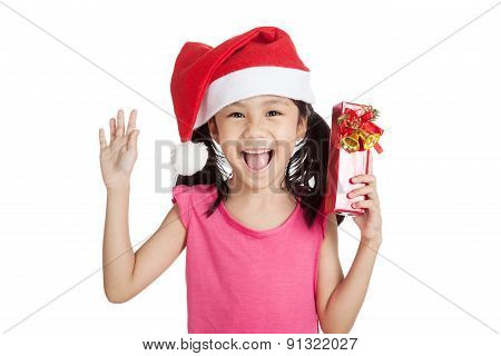 Little Asian Girl With Santa Hat And Gift Box