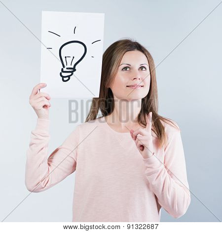 Woman Holding A Paper With Light Bulbs
