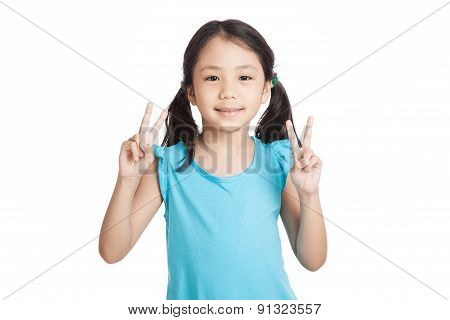 Little Asian Girl Show Victory Hand Sign
