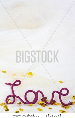 word love of red thread on fabric background