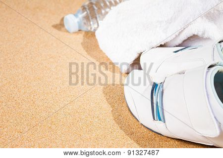 white sneakers in sand