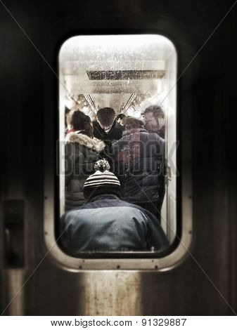 Instagram filtered image of a crowded subway car with commuters