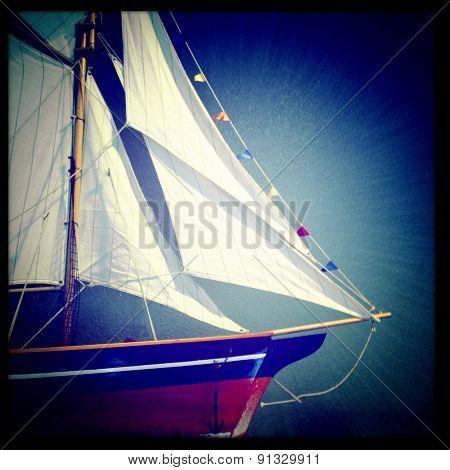 Instagram filtered image of a model sailing ship