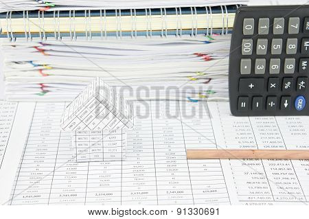 Bottom Of Pencil And House With Calculator On Finance Account