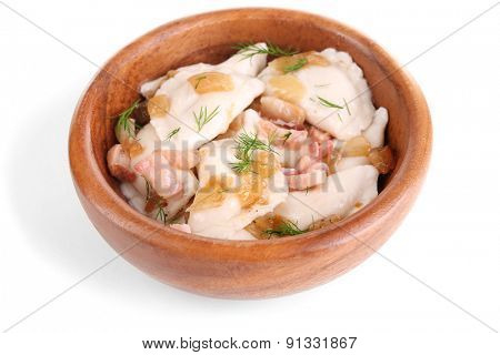 Tasty dumplings with fried onion in brown bowl, isolated on white
