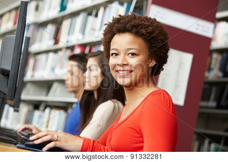 Girl working on computer in library