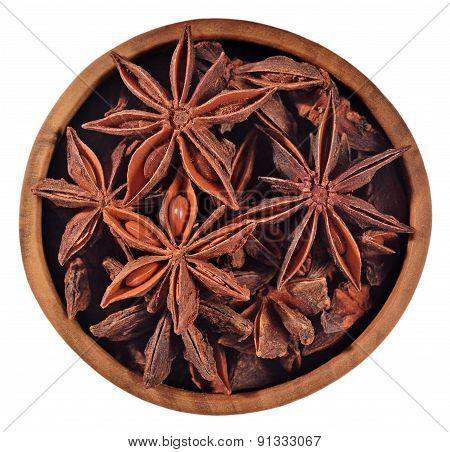 Star Anise In A Wooden Bowl On A White