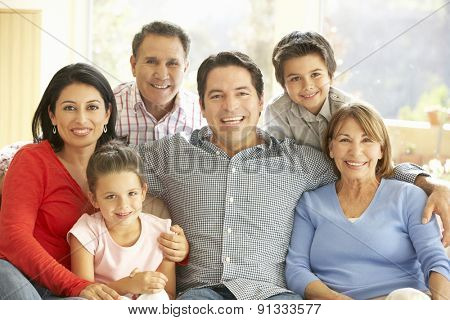 Portrait Of Extended Hispanic Family Relaxing At Home