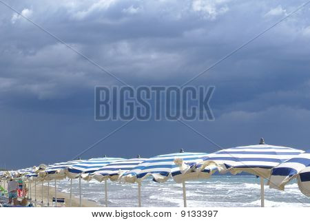 Beach & Umbrellas Waiting For The Storm