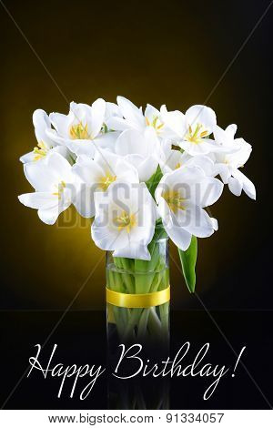 Beautiful bouquet of white tulips on dark background