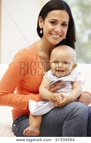Hispanic mother and baby at home