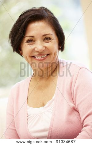 Senior Hispanic woman at home