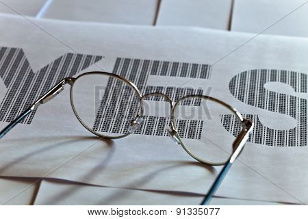 Glasses And Printed Text