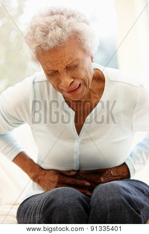 Senior woman with stomach ache