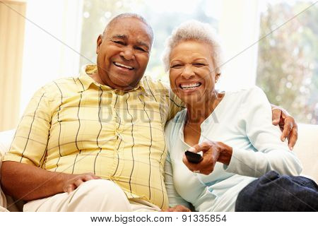 Senior African American couple watching TV