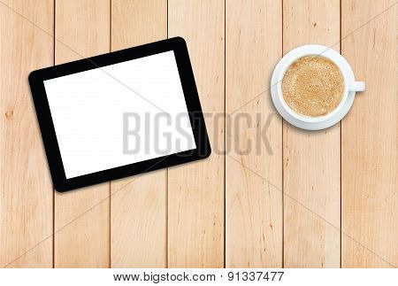 Tablet And Coffee On A Wooden Table