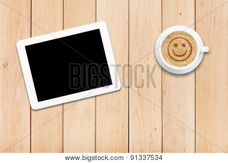 Tablet Pc And Coffee With Smile Sign