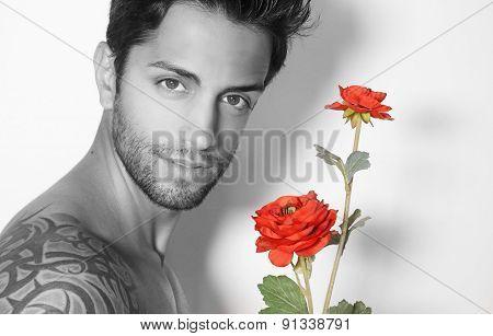 handsome man holding a flower