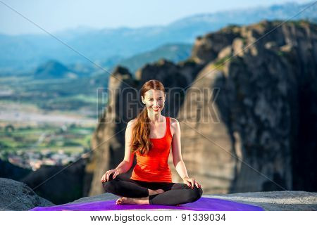 Woman meditating in the mountains