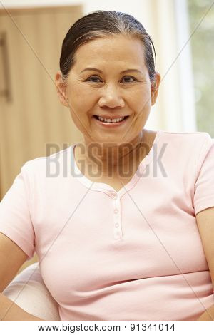 Senior Asian woman at home