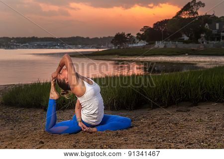 Female Yoga Model Eka Pada Rajakapotasana Mermaid Pose Beach