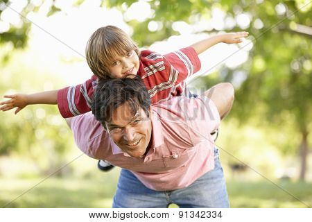 Father and son playing in park
