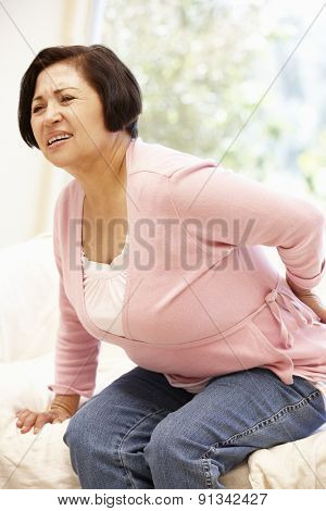 Senior Hispanic woman with backache